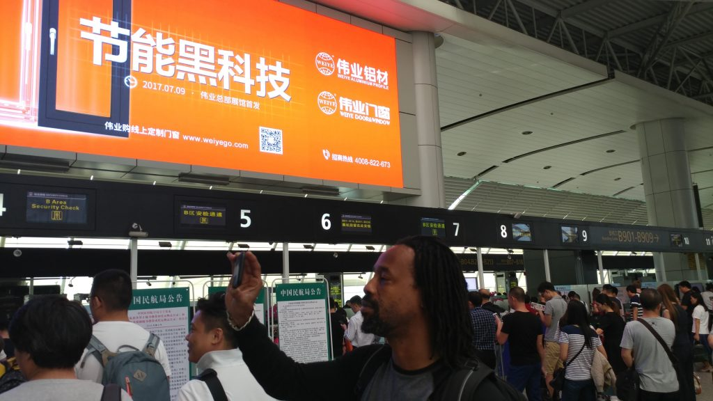 Reavis Mitchell In line for the security check at Guangzhou Airport